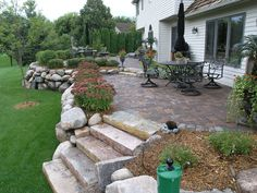 Glacial Fieldstone Boulder Wall With Chilton Steps Supporting A Anchor  Kingston Cobble Fieldstone Patio By Hedberg