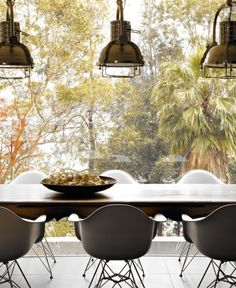Industrial lights, dining table, Eames Chairs