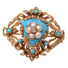 Circa 1870 Victorian Enamel Turquoise Pearl Diamond Gold Brooch | From a unique collection of vintage brooches at https://www.1stdibs.com/jewelry/brooches/brooches/