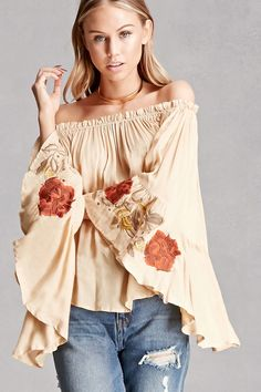 A woven top featuring an off-the-shoulder neckline, long bell sleeves with floral embroidery, and a flowy silhouette. This is an independent brand and not a Forever 21 branded item.