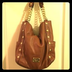 Michael Kors purse Tan, leather, gold detail. Great condition. Michael Kors Bags Totes