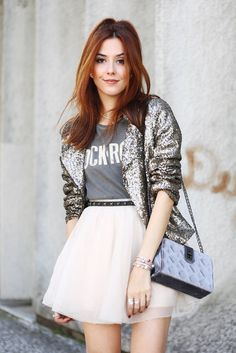 There's nothing better than a sequined jacket to rock an outfit. Wearing it during the day with tshirt, tulle skirt and black boots.