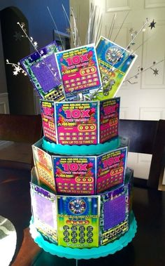 Lottery Cake- Birthday gift/Raffle ideas Made from scratch off Lottery tickets . Lottery Cake- Birthday gift/Raffle ideas Made from scratch off Lottery tickets and cardboard cupca 70th Birthday Parties, 60th Birthday Party, 18th Birthday Gift Ideas, Birthday Cupcakes, Birthday Surprise Ideas, 60th Birthday Presents, 50th Party, Grandma Birthday Gifts, 25th Birthday Ideas For Him