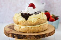 Cream Puff Cake has  has layers of cake and vanilla pudding. Topped with amazing chocolate ganache.