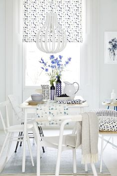 Bring interest to an all-white dining room scheme by mixing and matching different furniture styles. The pared-back palette draws attention to the varied shapes. For more dining room ideas visit housebeautiful.co.uk