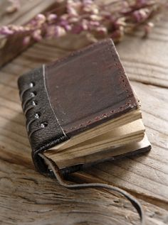 """Tiny 3""""  Leather Bound Journal.  Must remember to get a few of these for my son.  He will LOVE them!"""