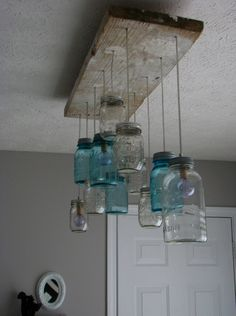 mason mason jar lights....guess they would blend in with the pallet wine cabinet and pallet wine bottle holder.