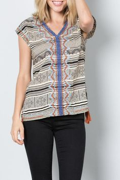 """Cap-sleeve top with black and beige tribal print and indigo sky blue and burnt orange embroidery. V-neck boxy fit with 2"""" side slits with tassels. Great paired with flared jeans and wedges for cocktails or with shorts for a more casual look.  Embroidered Tassel Tank by THML Clothing. Clothing - Tops - Casual Arkansas"""