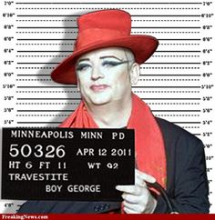 "Boy George wassentenced to 15 months in jail for falsely imprisoning a male escort by handcuffing him to a wall and beating him with a metal chain.    The judge told the 47-year-old former Culture Club front man, whose real name is George O'Dowd, he had left the escort ""shocked, degraded and traumatised"" by the ordeal.    O'Dowd was found guilty last month of attacking the Norwegian model Audun Carlsen, 29, after he visited the singer's flat in London in April 2007."