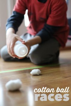 Cotton Ball Races:  A great boredom buster and excellent fine motor activity that builds the small muscles in the hands!
