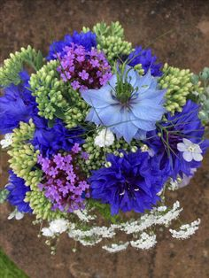Summer jam jar posy with nigella, sedum, cornflowers