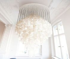 Capiz Chandelier....flat shells of windowpane oysters...when a breeze blows through it makes a relaxing sound...
