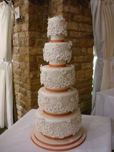 Five tier white daisy wedding cake