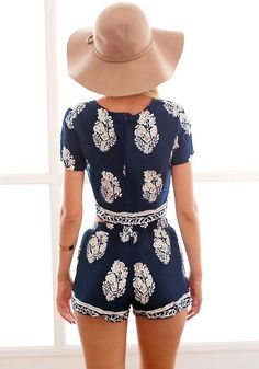 Back view of model in foliage print shorts co-ord set