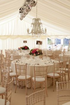 Pin from the-angels.com Marquee Wedding, Crystal chandelier, pretty pink floral, lime washed chivari chairs, ivory table linen