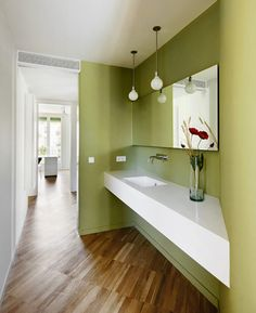 I love the long countertop with the white and green contrast!