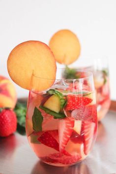 Rose' Sangria with strawberries, peaches, basil and champagne