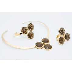 The Catrin Triplet collection with Smokey Quartz stones in gold.