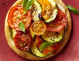 """Zucchini Tarts    1. Heat oven to 425°F. Cut 1 refrigerated pie dough into four 4"""" circles. Transfer to oiled baking sheet.    2. Spread each with 2 tsp goat cheese and 1/2 tsp olive tapenade. Top with 5 thin rounds zucchini and 6 slices cherry tomato.    3. Bake until golden, 10-12 min.    NUTRITION (per serving) 153 cal, 3 g pro, 14 g carb, 1 g fiber, 10 g fat, 4.5 g sat fat, 187 mg sodium"""