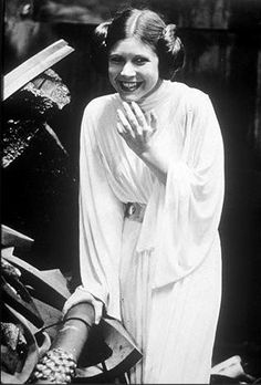 Carrie Fisher laughing on the trash compactor set.