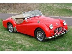 Early 1957 TR3 Triumph. Red; just like mine.