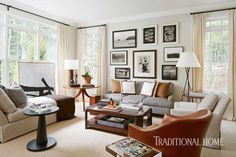 A gorgeous gallery wall creates a focal point in this space. - Photo: Werner Straube / Design: Robert Brown