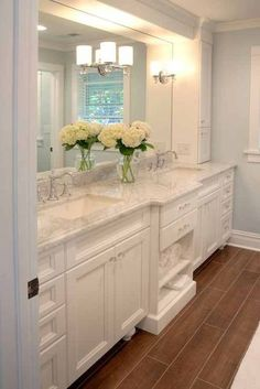 White Bathroom With Carrera Marble Counters, Open Towel Storage    Such A  Perfect Master Bathroom. I Would Use A Slightly Darker Grey Marble  Countertop With ...