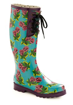 A little rain cant dampen your passion for fabulous floral fashion! With these rain boots by Betsey Johnson your beauty will keep on blooming through the stormiest situations. These boots' vibrant palette of grape trim and hot pink art roses scattered across a robins egg-blue background ward away the gloom of grey skies while treaded purple soles and lace-up details root your look in pretty practicality. Plant this pair alongside patterned fishnets a metallic skirt a primary-colored coat and…