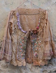 Baroque inspired romantic jacket, hand dyed in sand and cream, has been reworked with beautiful ornate antique laces and vintage trims.