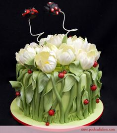 Gorgeous cake featured edible sugar white tulips, lots of ladybugs, and 2 love bugs cake toppers