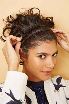 """Put the second headband in at an angle so it crisscrosses with the first. """"You can also use a single, long elastic ribbon and wrap it around your head twice,"""" says Lynch."""