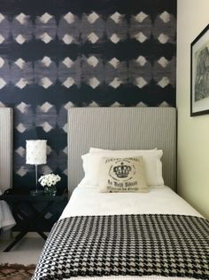 In this black and white bedroom, pattern and texture have been cleverly mixed to create a cosy feeling without using colour; the Elitis wallpaper behind the bed is Tears from Paradise.