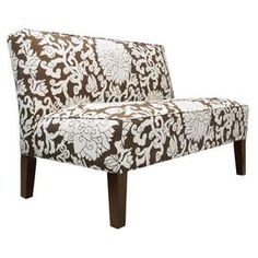 "The perfect accent for your living room seating group or master suite ensemble, this eye-catching settee showcases a lovely floral motif in a rich chocolate palette.     Product: Armless settee  Construction Material: Solid pine frame, polyurethane foam and polyester fill foamColor: ChocolateFeatures:Floral motif   Dimensions: 33.5"" H x 50"" W x 31.5"" D  Cleaning Instructions: Spot clean only"