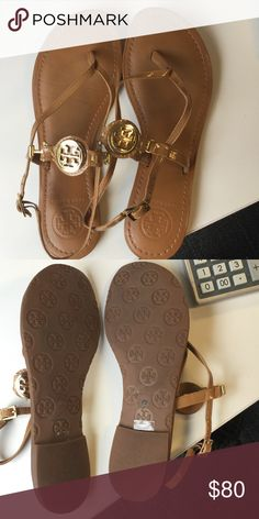 "Tory Burch Ali Sandals Gently used Tory Burch Ali sandals. 100% authentic. Sandals are nude patent leather with adjustable strap. ""T"" logo is gold. Heels have slight wear on bottom, but in overall excellent condition. Doesn't come with box, just shoes. Tory Burch Shoes Sandals"