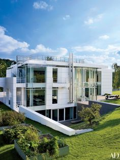 A home designed by Richard Meier & Partners Architects for a family in Luxembourg is clad in expanses of glass and aluminum panels enameled in Meier's hallmark white.