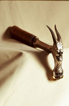Have an ordinary 'Estwing ' hammer ( the handle is distinctive ) but never observed such a stylised one like this , special commission ? Wonder if more decorative show piece for a man cave , as removing nails with spacing of those stylised 'horns 'may be problematic ?