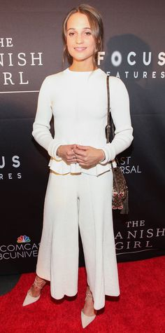Alicia Vikander got winter white right at the Washington, DC premiere of The Danish Girl in a peplum top and matching culottes, both by Victoria Beckham, complete with a Louis Vuitton cross-body and neutral lace-up Aquazzura pumps.