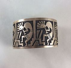 """Territorial Indian Arts  Vintage Hopi Pueblo Indian sivler cuff bracelet is 1 1/2"""" wide and measures 6"""" end to end plus a gap of 1 1/4"""".  Sterling silver overlay with cutouts of Kokopelli times four."""