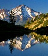 Mount Shasta, a volcano in the Cascade Range is one of California's highest and most beautiful mountains.