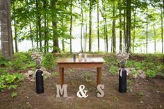 DIY wedding ceremony table, wood initials | Maggie & Shahul's intimate Virginia wedding at Lake Anna | Images: Photography by Anna Clark