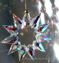 Bohemian Crystal Prism Star SunCatcher makes rainbows on the walls.