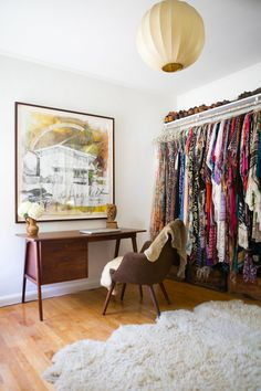 ALLY this clothes hanging method would work for your bedroom....a long piece of wood shelf with curtain/closet rod hanger attached (i think i have those hangers here)