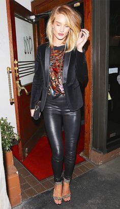 Rosie Huntington-Whiteley wearing a velvet tuxedo jacket, printed top, black leather pants, and embellished ankle strap heels