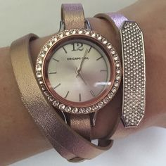 Origami Owl Triple wrap watch Origami Owl Triple wrap watch. Includes a triple leather wrap in rose gold, along with a rose gold Swarvaroski crystal locket face, and pave slider. This is even more gorgeous in person! Origami Owl Jewelry Bracelets
