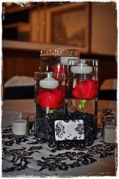 red submerged centerpieces | Black and White wedding Centerpieces Idea with a touch of red
