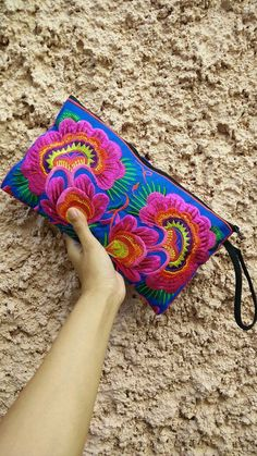 Retro Embroidery Ideas Embroidered Retro Hippies Neon Floral Wallet by TribalSpiritShop - A Hmong Style Clutch Bag with Traditional Tribal Embroidery. This Bag exhibits brilliant colours with unique embroidered patterns. Learn Embroidery, Vintage Embroidery, Embroidery Ideas, Retro Backpack, Elephant Fabric, Bohemian Gypsy, Bohemian Style, Crazy Colour, Woven Bracelets