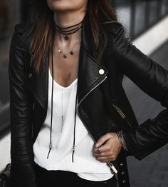 layered necklaces and leather jacket