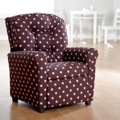 Featuring the modern style of a pink and brown color combination the polka dot clad Dozydotes Pink a Dot 4-Button Child Recliner will complement your contemporary decor while giving your fashion-forward child a custom-sized place to relax. A classic 4-button back design provides exceptional support and a traditional touch. This attractive chair features plenty of padding a reclining back and an extending foot rest for amazing comfort for your chi