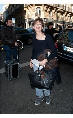 69108783bfa7 Jane Birkin carrying a  Birkin bag Lou Douillon