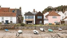 The studio designed the two-bedroom house to mimic the irregular clusters of cottages and terraces that characterise the conservation area in the north Norfolk seaside town. British Architecture, Amazing Architecture, Wells Next The Sea, Norfolk House, Two Bedroom House, House Names, Cathedral City, Dark Wood Floors, Corten Steel